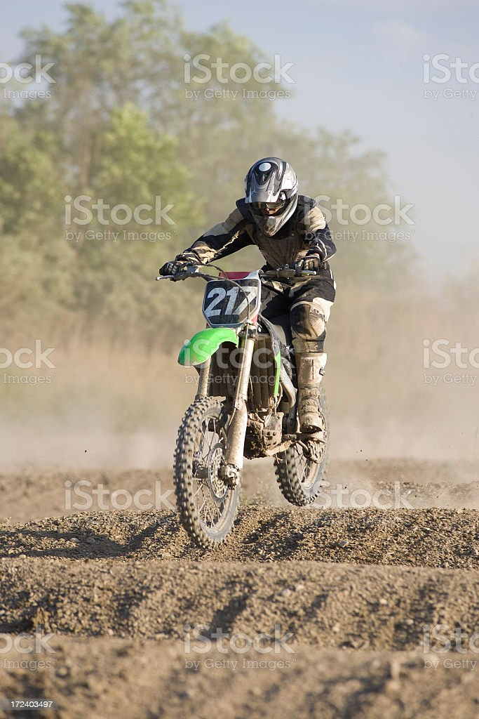 Motocross-rider on whoops section stock photo