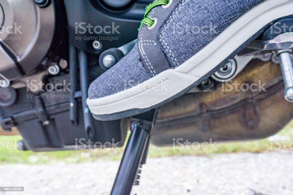 motocycle foot rest position during change gear stock photo