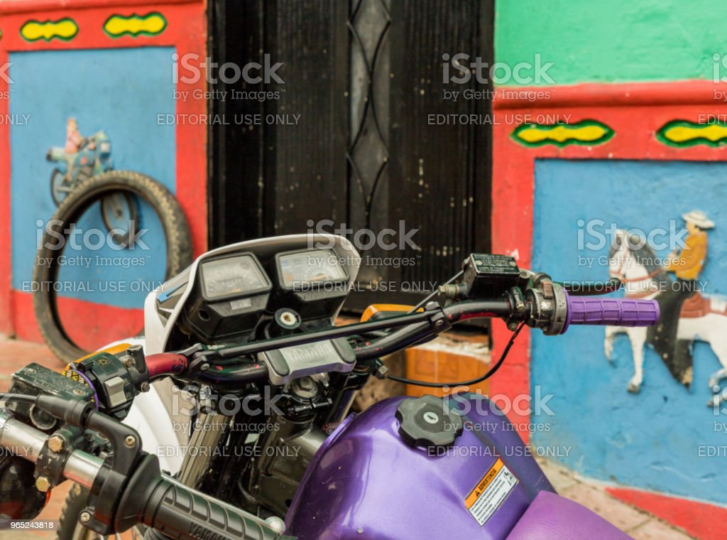 A motor bike agaist a colorful wall. royalty-free stock photo