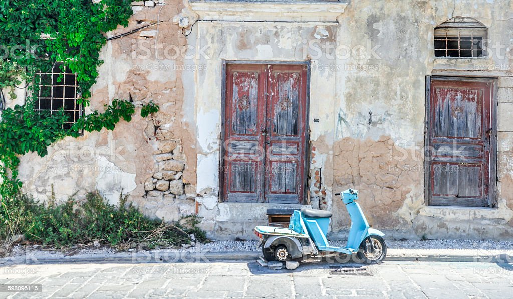Motor bike in Old Town of Rhodes, Greece stock photo