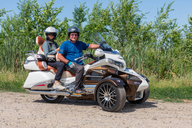 Motor bikers at tricycle Honda Goldwing making drive through Hungary Eger, Hungary - July 04, 2019: Motor bikers at tricycle Honda Goldwing making a drive through Hungary between Budapest and Eger three wheel motorcycle stock pictures, royalty-free photos & images