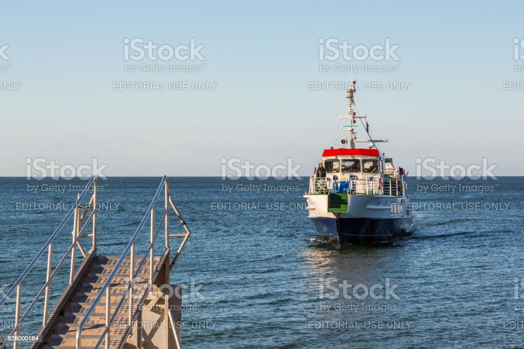 Motor boat approaching shore. stock photo