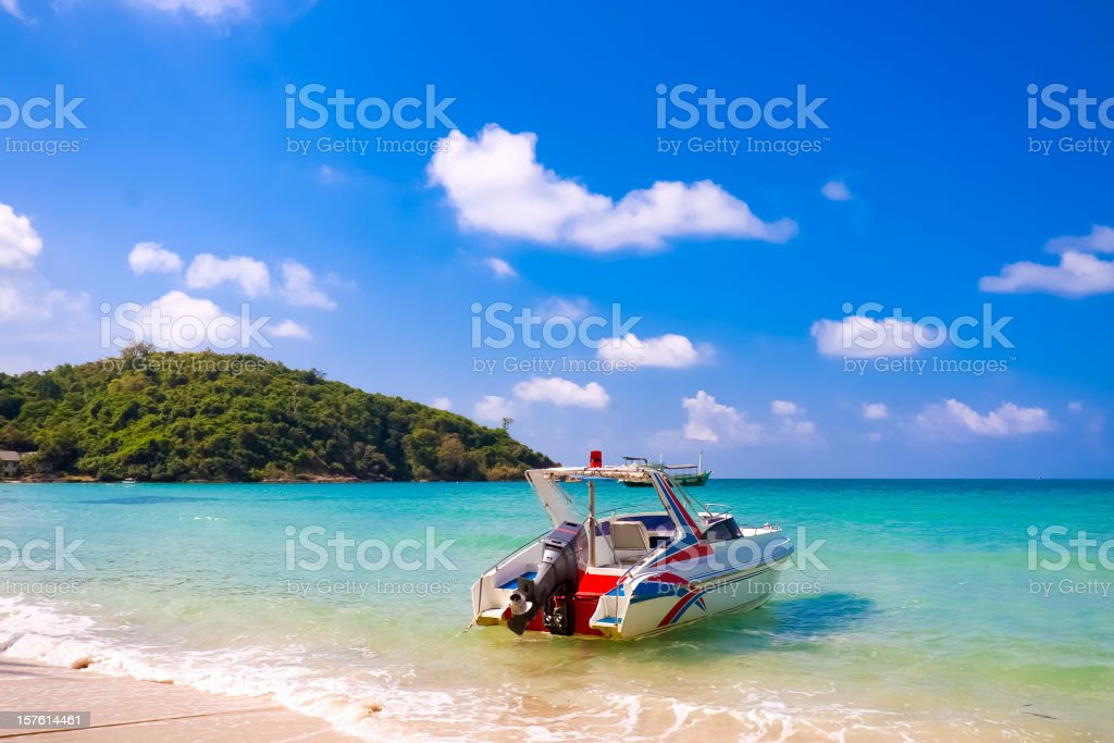 Motor boat at the water's edge on Koh Samet beach, Thailand stock photo