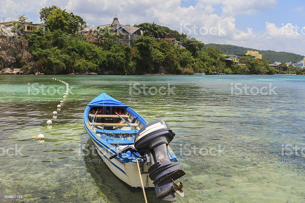 Motor boat in transparent water of Caribbean sea, Jamaica stock photo