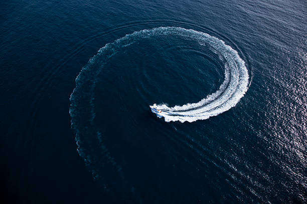Motor boat making a turn in form of a swirl stock photo