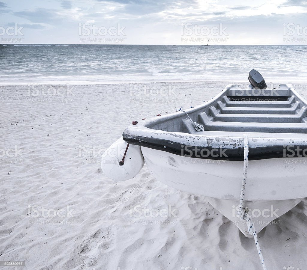 Motor boat on a tropical beach. stock photo