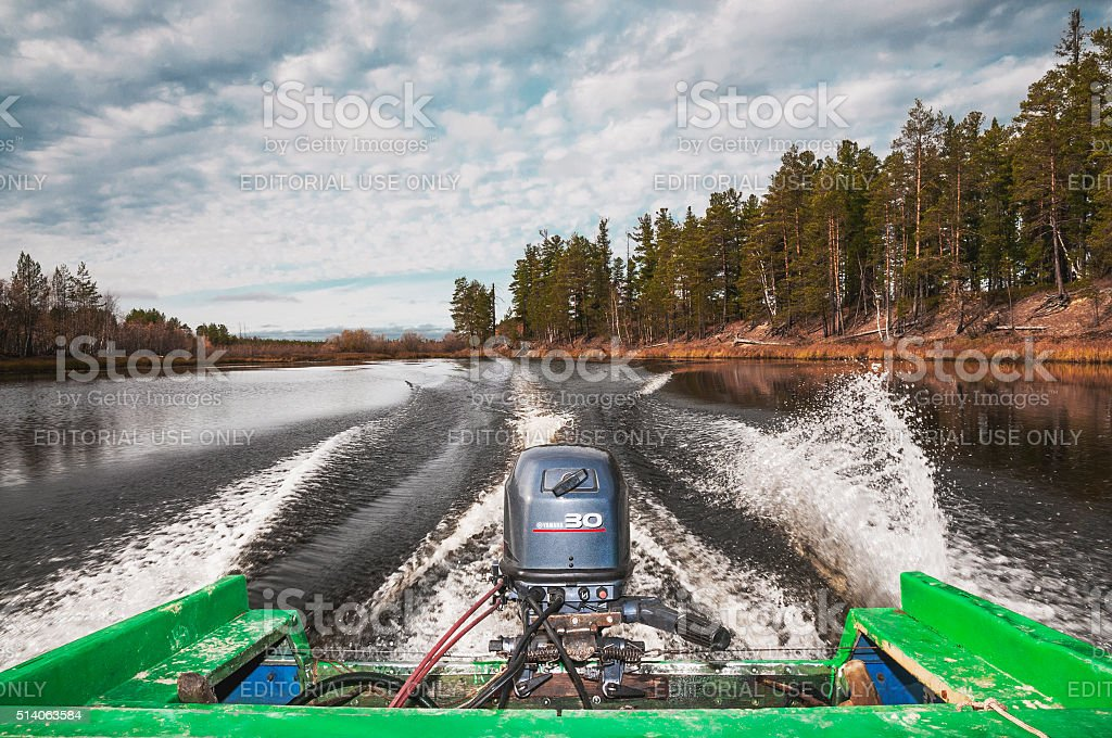 Motor boat on the river in West Siberia. stock photo