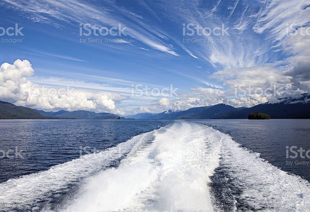 Motor Boat Trail in Calm Ocean Waters stock photo