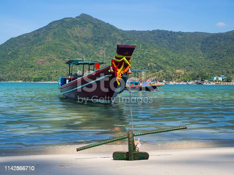 Motor boat with an anchor near the island. Koh Phangan Thailand