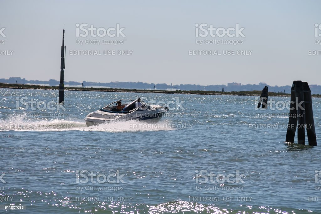 Motor boat with tourists in the Adriatic Sea near Vienice, Italy stock photo
