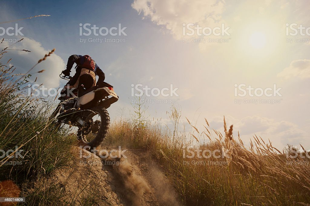 Motor cross rider on dirt track on sunny day stock photo