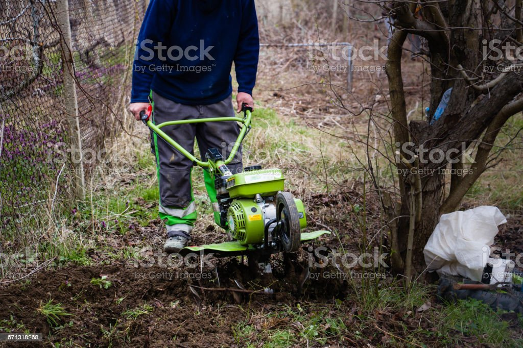Motor - cultivator at the ploughed garden. stock photo
