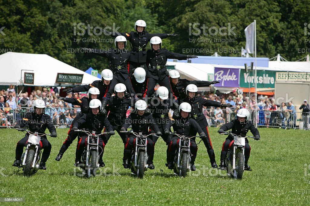 Motor cycle display team, perform a tricky pyramid move stock photo
