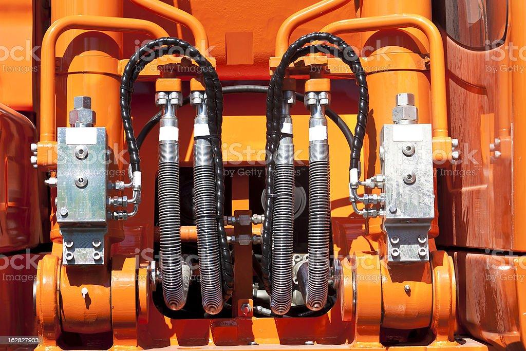 motor engine of machine with black pipes on orange royalty-free stock photo