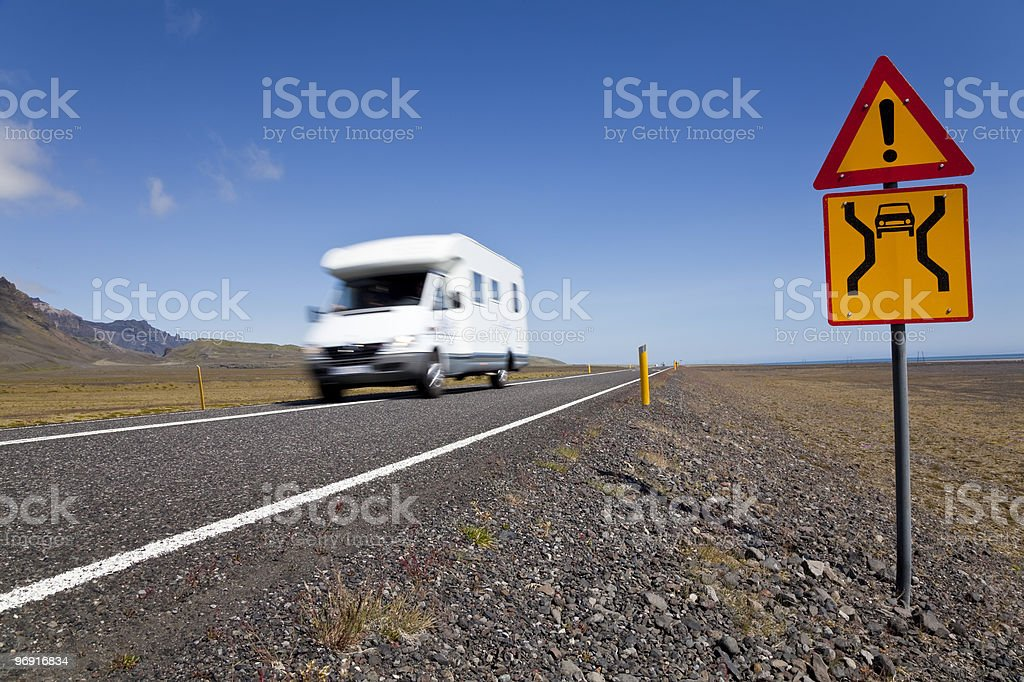 Motor Home Driving On An Open Road With Danger Sign royalty-free stock photo