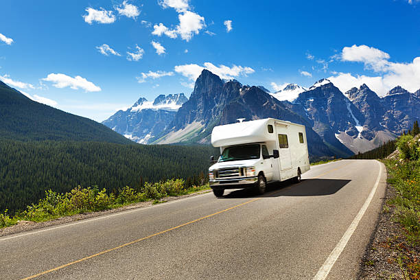 motor home on road trip tour, banff national park, canada - motorhome stock photos and pictures