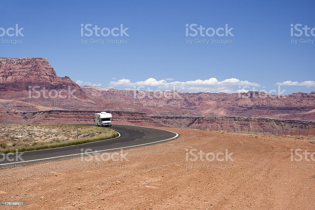 Motor Home Traveling through Desert royalty-free stock photo