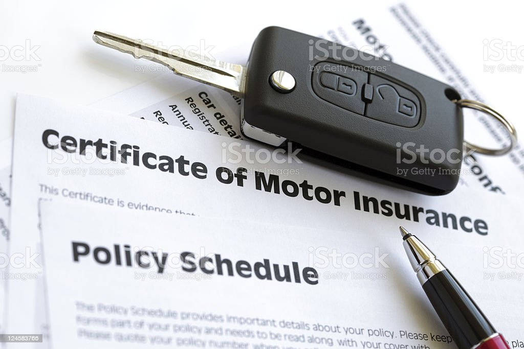 Motor insurance certificate with car key stock photo