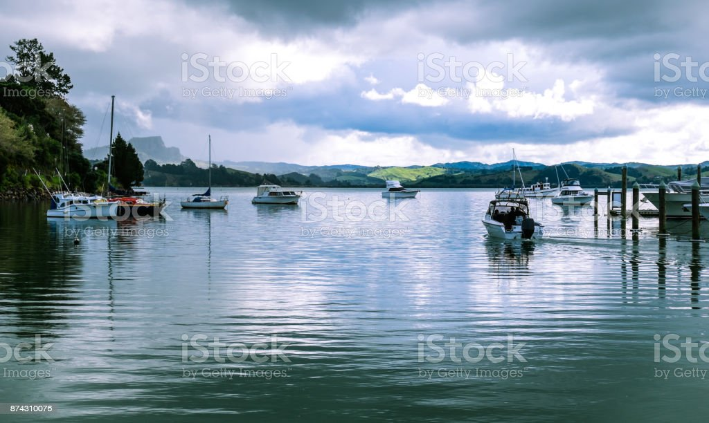 Motor launch motoring out of Whangaroa Harbour marina, Far North, Northland, New Zealand, NZ, on a winter day stock photo