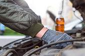 istock Motor oil check. 1035448012
