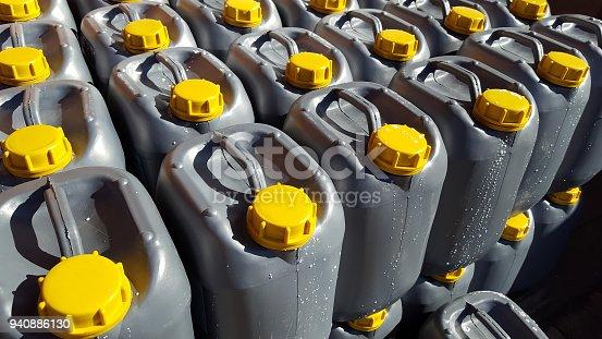 istock Motor oil in plastic canister 940886130