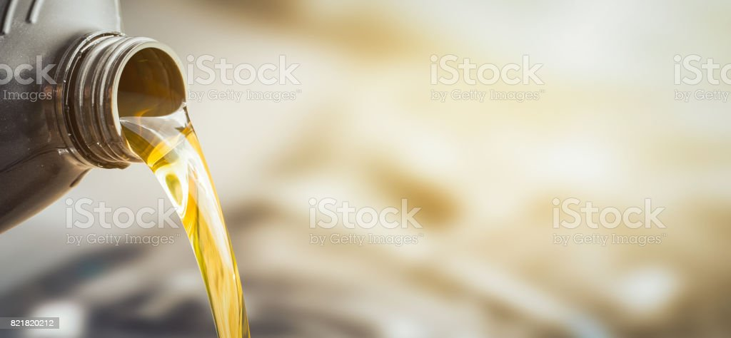 Motor oil pouring. stock photo