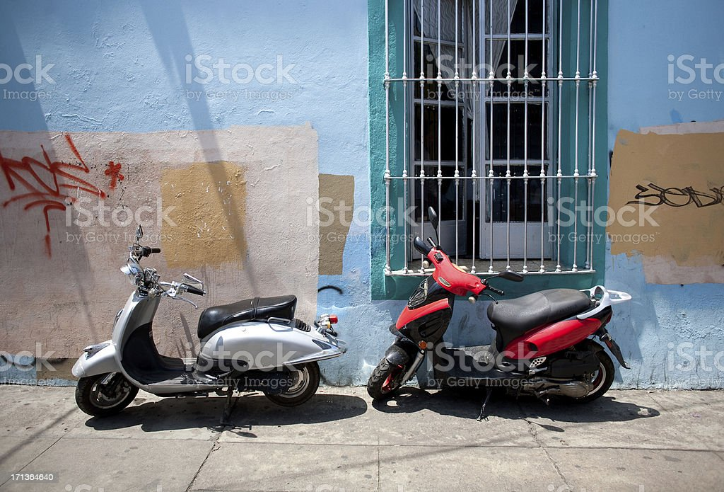 Motor scooters in third world setting stock photo