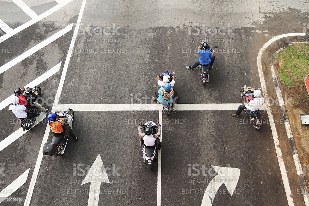 Motor scooters waiting for green royalty-free stock photo