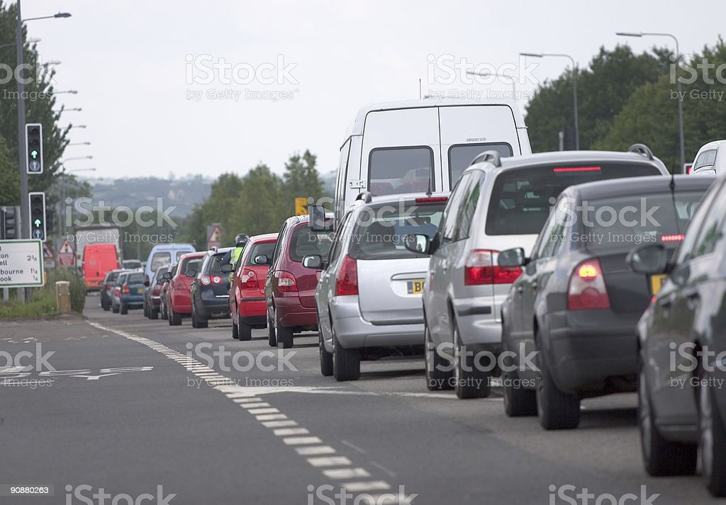Motor Vehicle congestion at traffic lights in rush hour, UK. stock photo