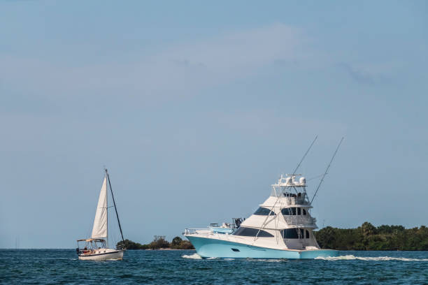 Motor yacht and sailboat about to pass each other in Florida