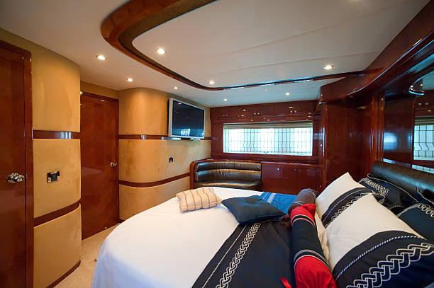 Motor yacht bedroom stock photo