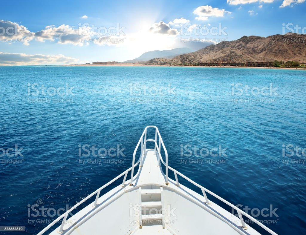 Motor yacht in a bay stock photo