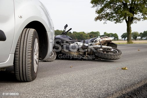 Motorbike Accident on the road with a car