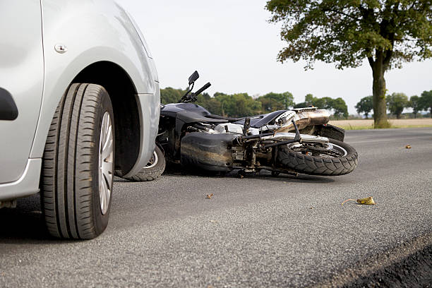 Motorbike Accident Motorbike Accident on the road with a car misfortune stock pictures, royalty-free photos & images