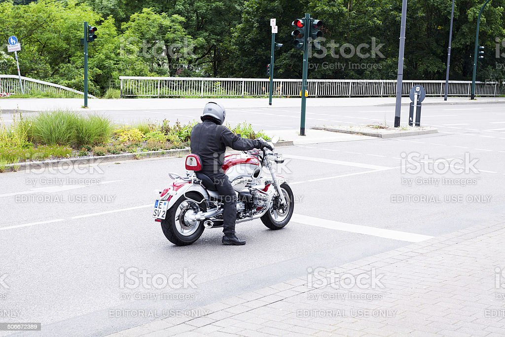 Motorbike brand BMW at traffic light royalty-free stock photo