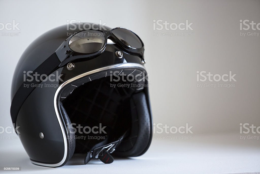 motorbike classic helmet with traditional glasses for protection. stock photo