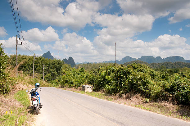 motorbike in a  karst landscape - motorbike, umbrella stock photos and pictures