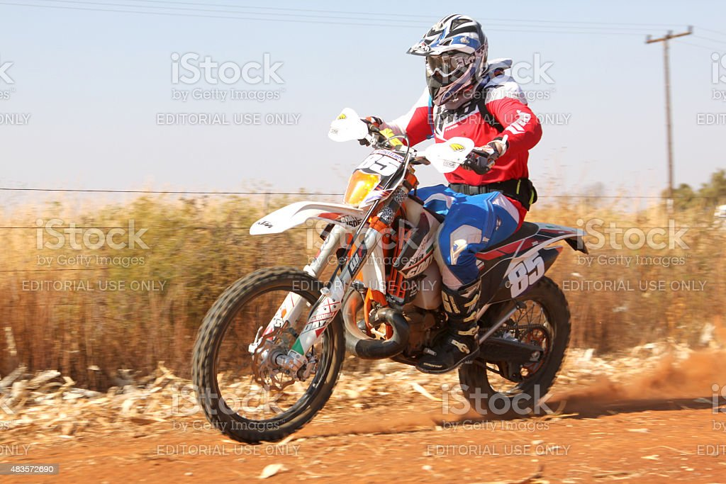 Motorbike kicking up trail of dust oat rally stock photo
