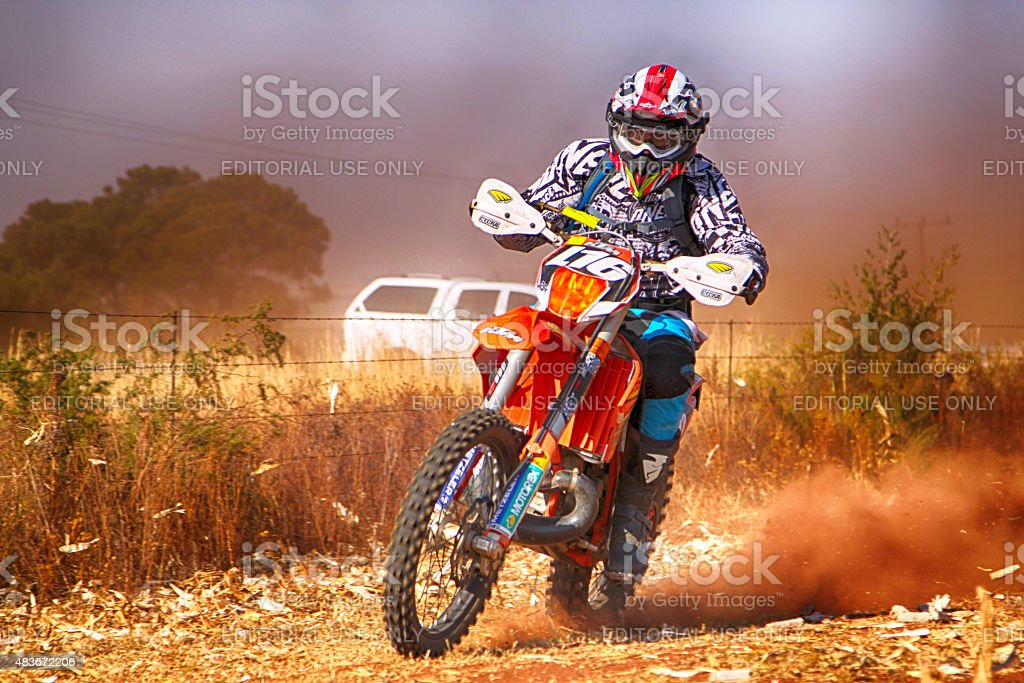 HD - Motorbike kicking up trail of dust stock photo