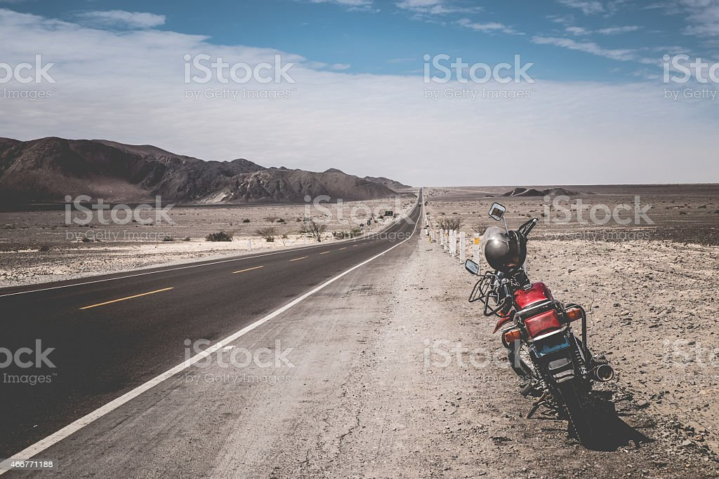 Motorbike on the Pan-American Highway in Perù stock photo