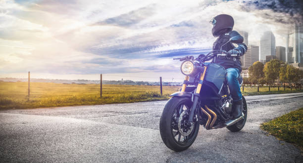 motorbike on the road in nature landscape - motorcycle stock photos and pictures