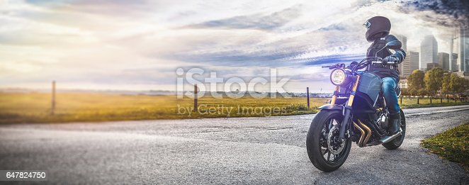 istock motorbike on the road in nature Landscape 647824750