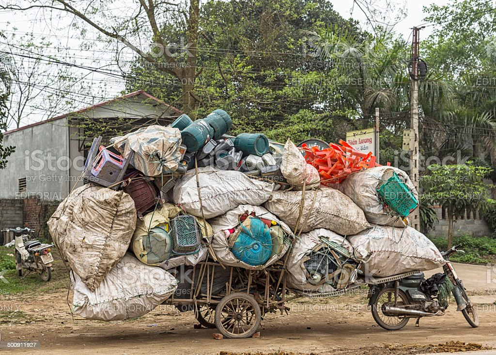 Motorbike plus cart loaded with recycled plastics. stock photo