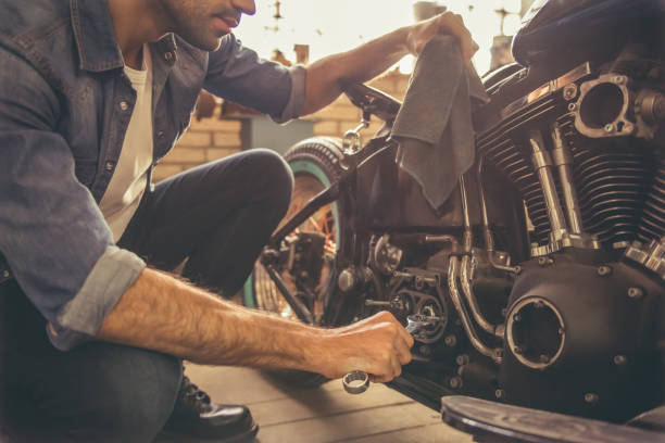 motorbike repair shop - motorcycle stock photos and pictures