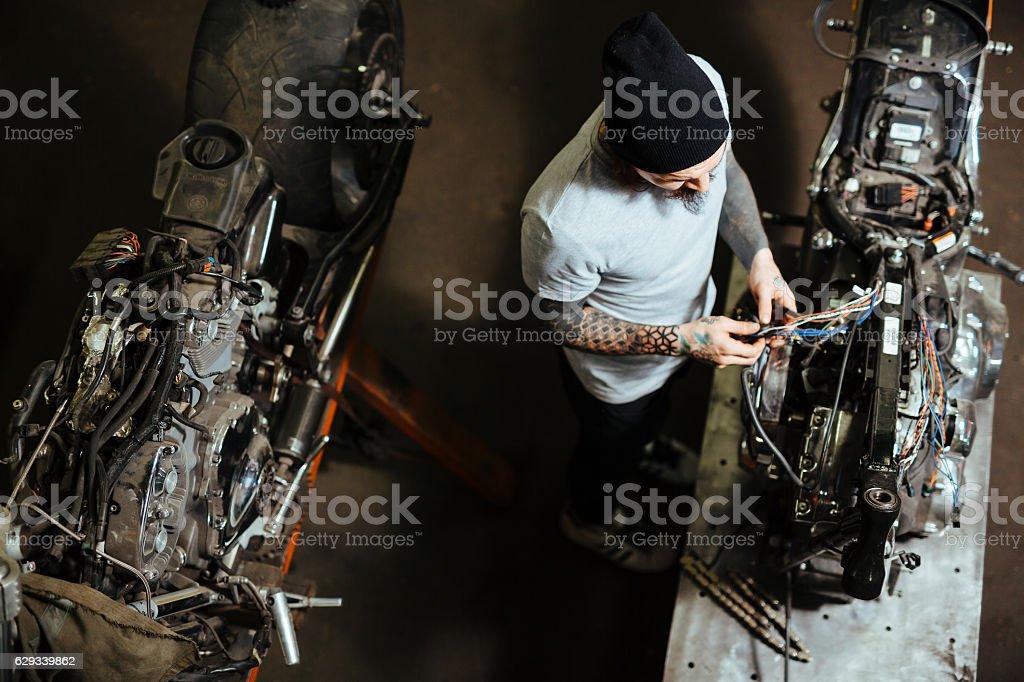 Motorbike repairman stock photo