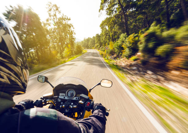 motorbike ride on a country road - motorcycle stock photos and pictures