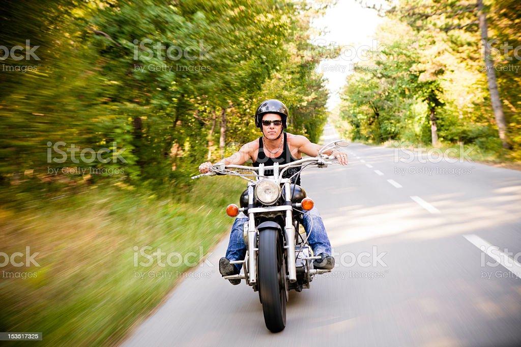 Motorbike rider in motion, blurred background stock photo