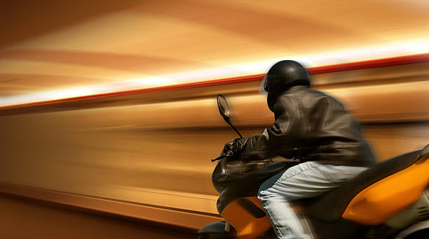 Motorbike Rider in Motion stock photo