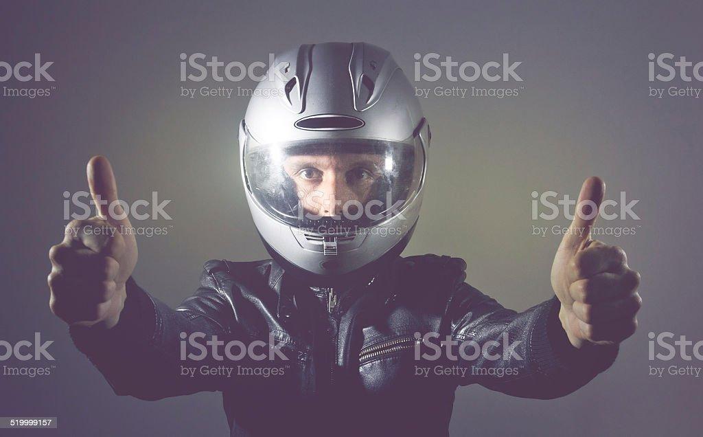 Motorbike Rider with Helmet Thumb Up stock photo