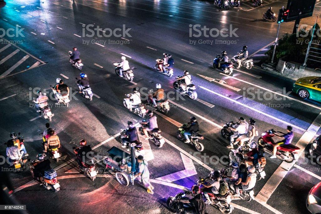Motorbike traffic at night in Bangkok stock photo